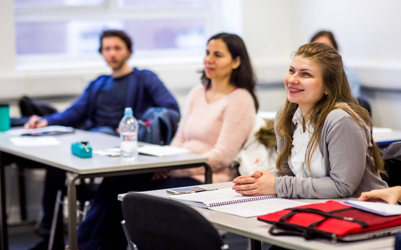 course_units_student_smiling_in_class