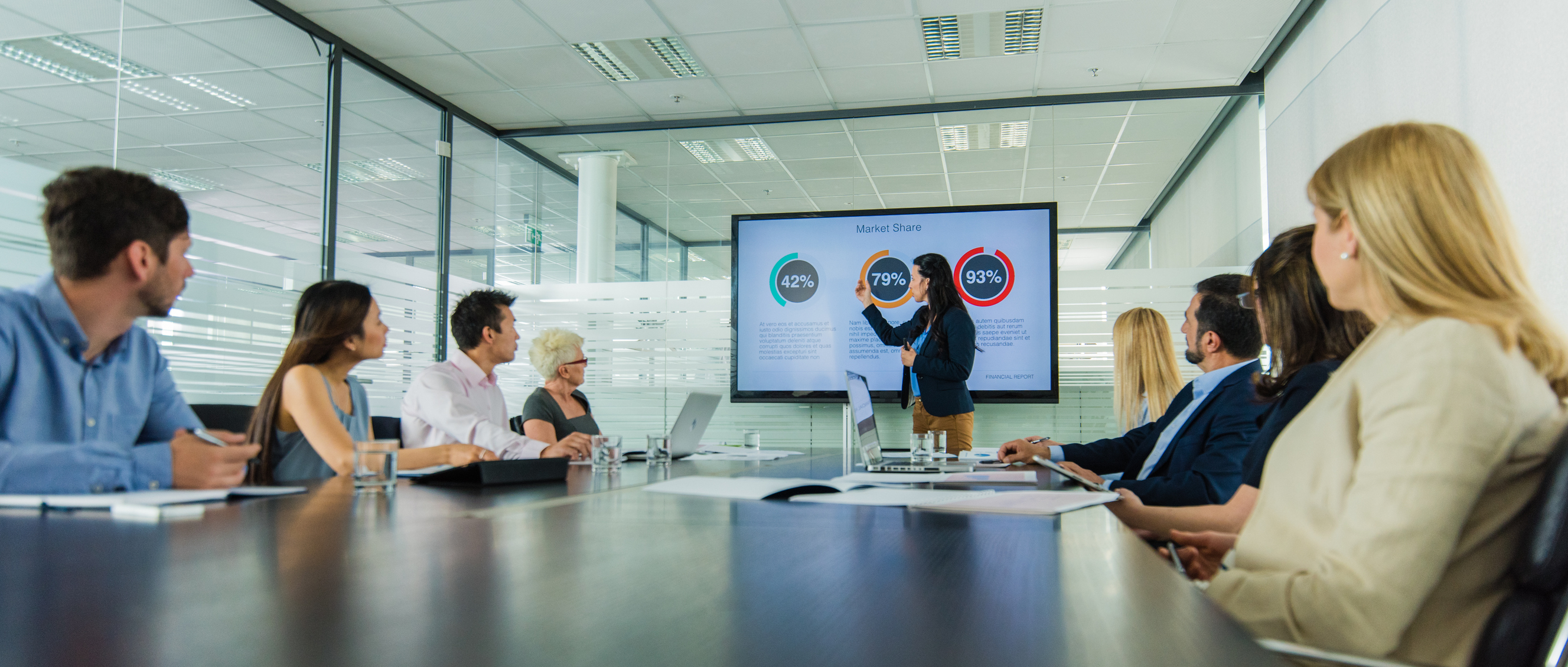 Businesswoman giving presentation in conference room.