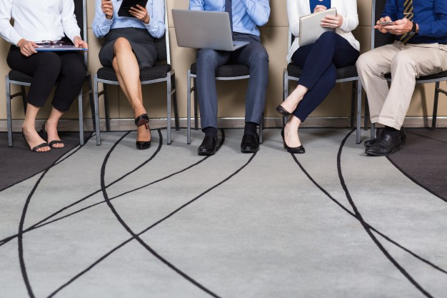 cropped-view-business-people-sitting-row_1262-1794